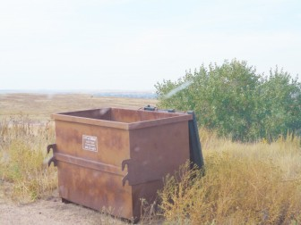 Nothing in this rusty old Dumpster, behind the gas station near Cabela's.