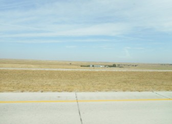 A lot of isolated buildings are visible from the road.