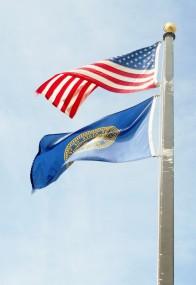 ]The majestic flags of the U.S. and Nebraska.